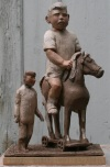 Boy with Toys by James Stewart, Painted Terracotta 20 x 12 x 8