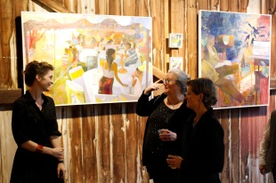 Greeting guests, paintings by Perky Edgerton Photo by Onyx Clemons
