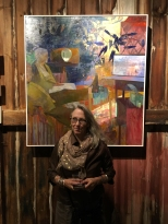 Painter Perky Edgerton with her painting Evening News at Kings Oaks