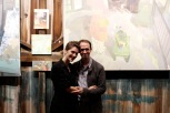 Art at Kings Oaks Co-Directors, theatre artist Clara Weishahn and painter Alex Cohen with paintings by Susan Lichtman. Photo by Onyx Clemons