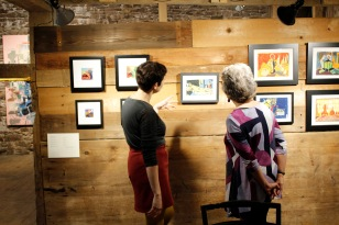 Artist Rotem Amizur with her artwork and Kings Oaks volunteer Diana Resek. Photo by Onyx Clemons