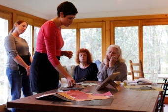 Rotem Amizur demonstrates creating a painted paper collage in her workshop at Kings Oaks as artists Kim Poulsen, Marsha Cudworth, and Tina Dadian look on.