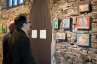 Eric Holzman with Alex Cohen's paintings