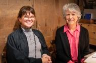 Volunteers Teresa Hopkins and Diana Resek.