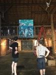 Brian and Ron hanging Benjamin King's paintings
