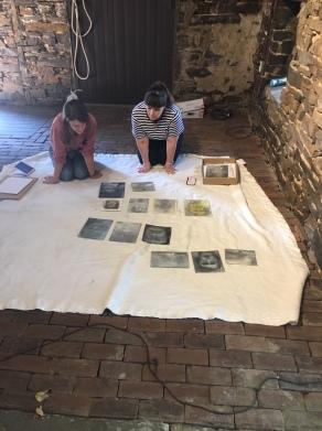Clara and Andrea installing David Fertig's drawings