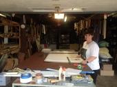 Kings Oaks intern Andrea Magnusdottir preparing works for the portfolio display