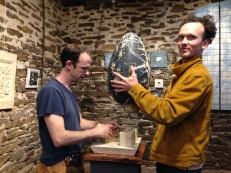 Alex Cohen and Brian Guerin installing Wells Vissar's scagliola egg sculpture in the chapel
