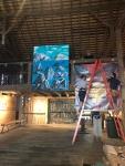 Hanging Benjamin King's paintings in the barn