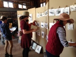 Workshop participants hanging up their monotypes