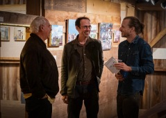 A visitor with artists Alex Cohen and Drew Panckeri